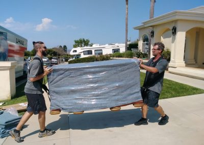 Sterling Interstate moving company - staff loading furniture