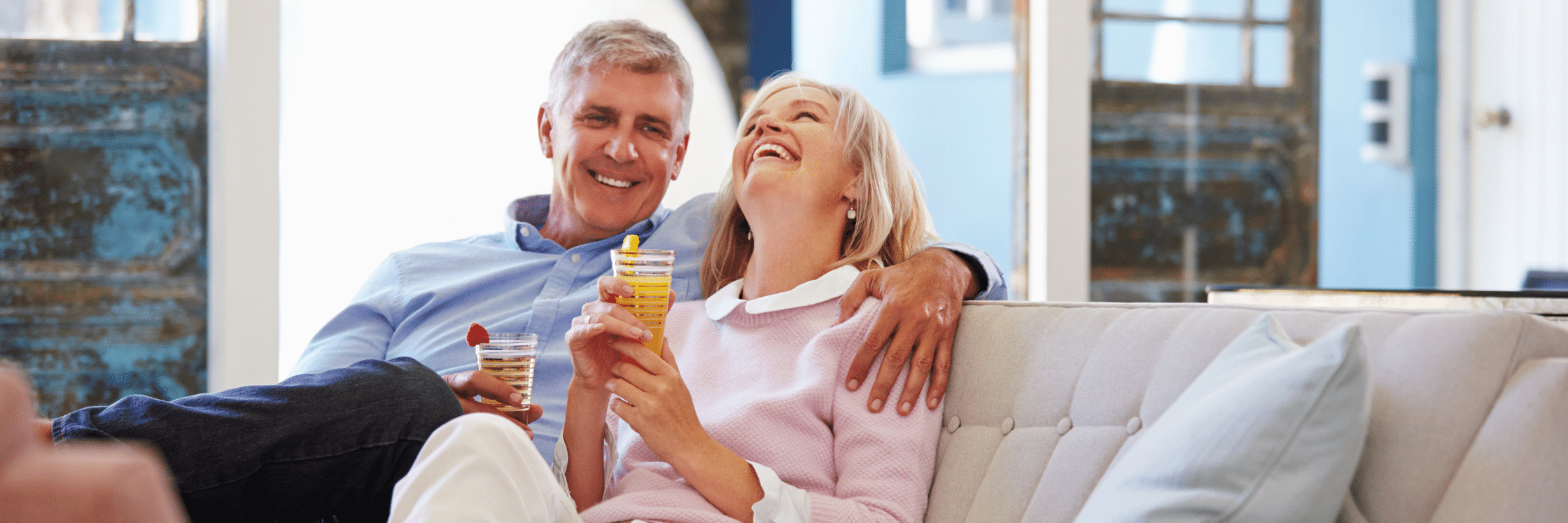 Elderly Couple Enjoying drinks on the couch